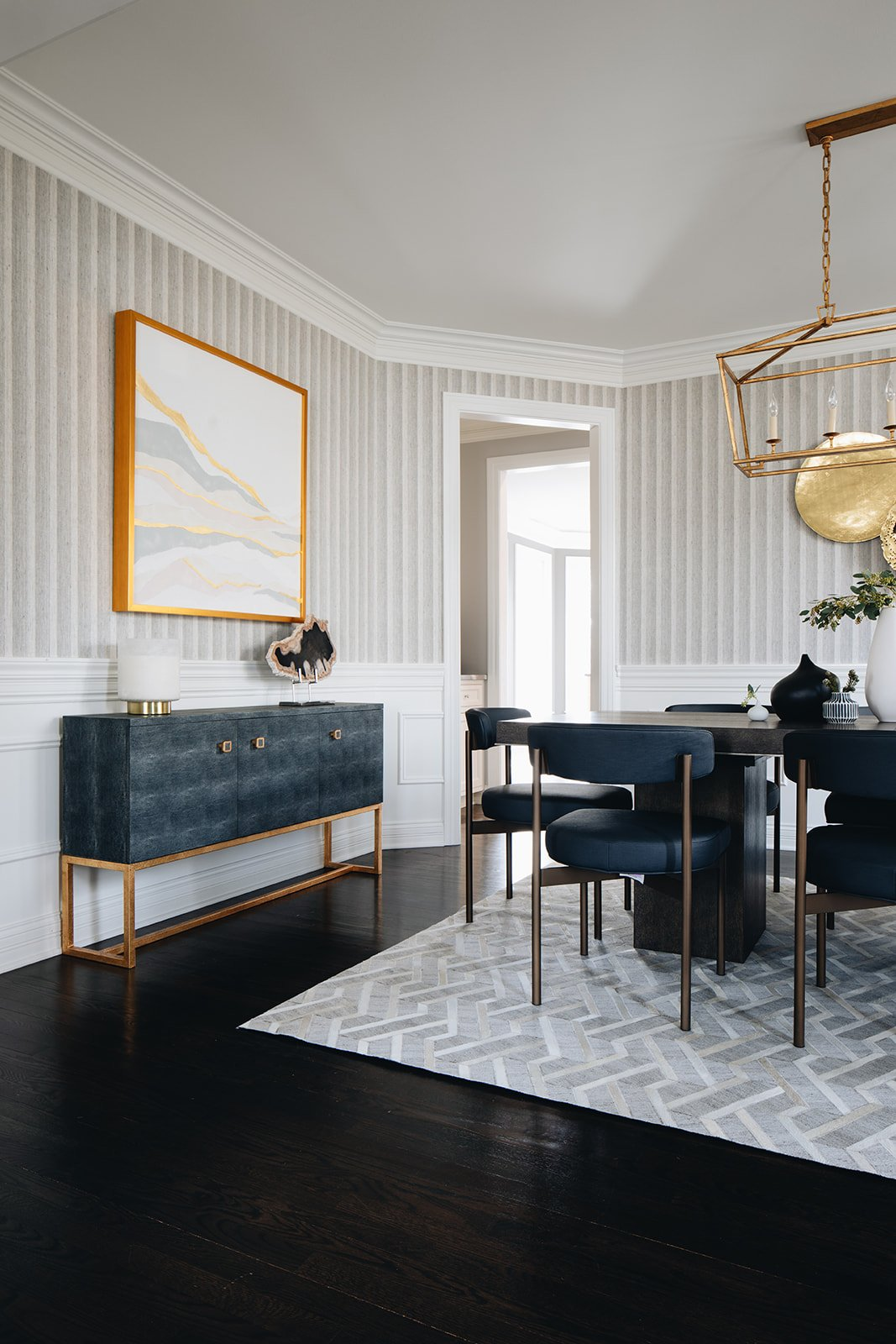 dining room table with buffet and wall art