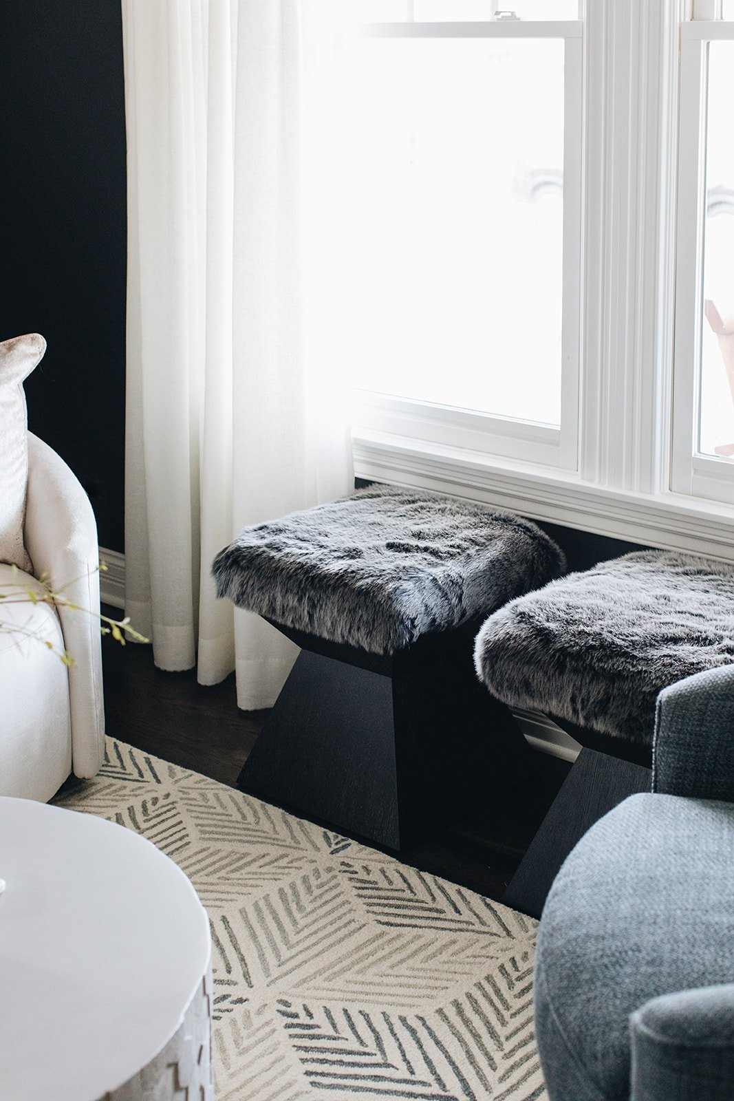 fuzzy living room ottomans by window