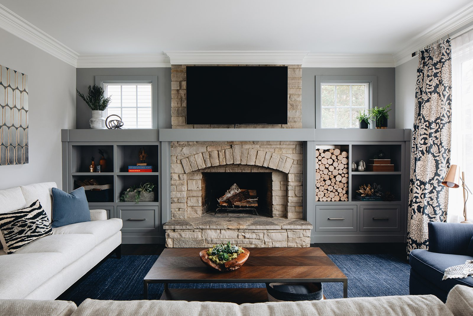 wide view of family room with stone fireplace