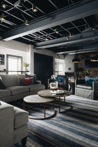 basement sitting area with exposed ceiling