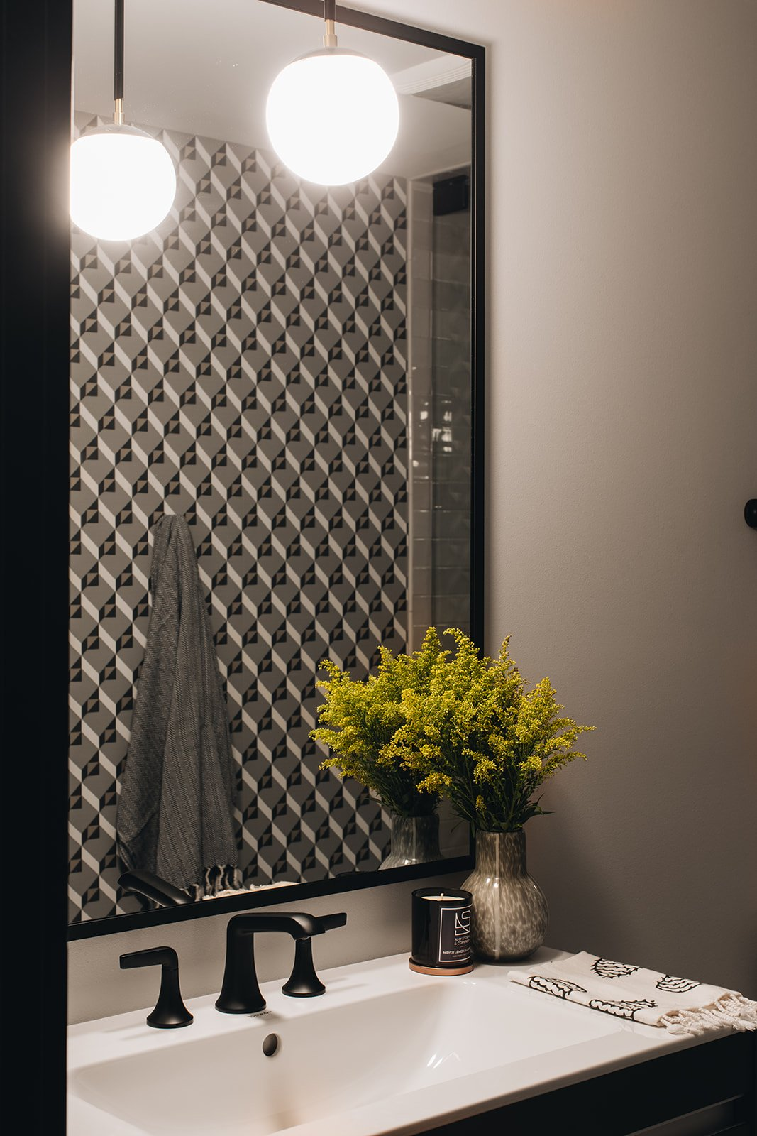 bathroom mirror with wall covering